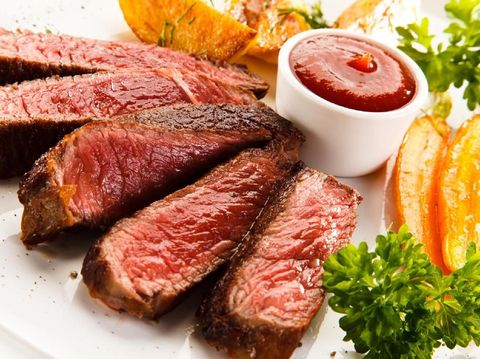 Grilled beefsteak with baked potatoes on white background
