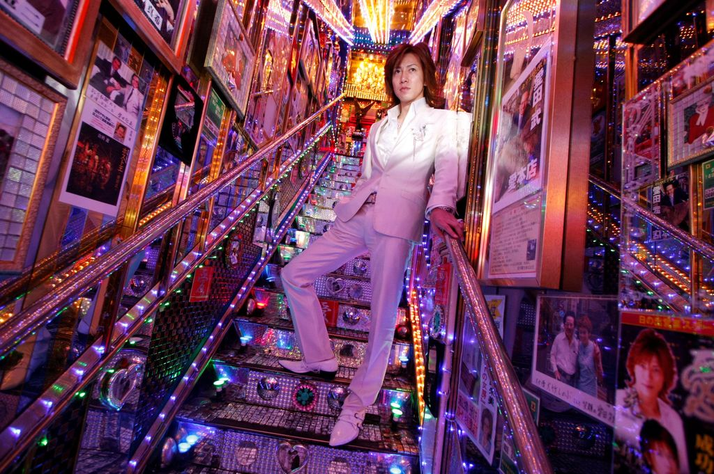 Hikaru Aizawa, who entertains female customers as a host in a club in Tokyo's red light district, poses for a photograph at his host club in Tokyo's Kabukicho nightlife district, Japan, June 25, 2009. REUTERS/Toru Hanai      SEARCH