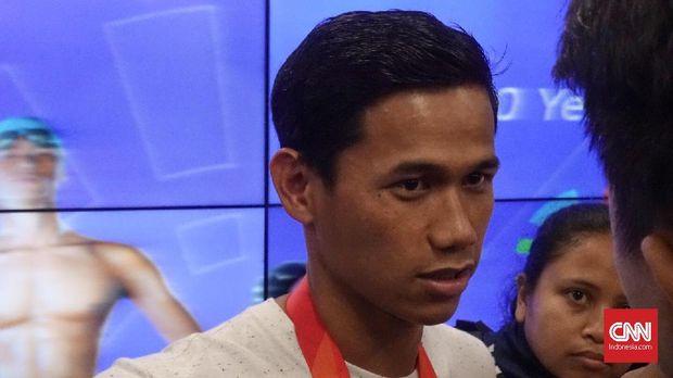 Jendi Pangabean memastikan medali emas kedua Indonesia dari cabang para swimming. (CNN Indonesia/Andry Novelino)