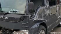 Mobil yang Terbalik di Margonda Milik Densus Pengantar Tahanan
