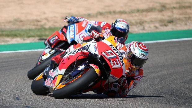 Marc Marquez berhasil mengalahkan Andrea Dovizioso pada balapan MotoGP Aragon 2018.