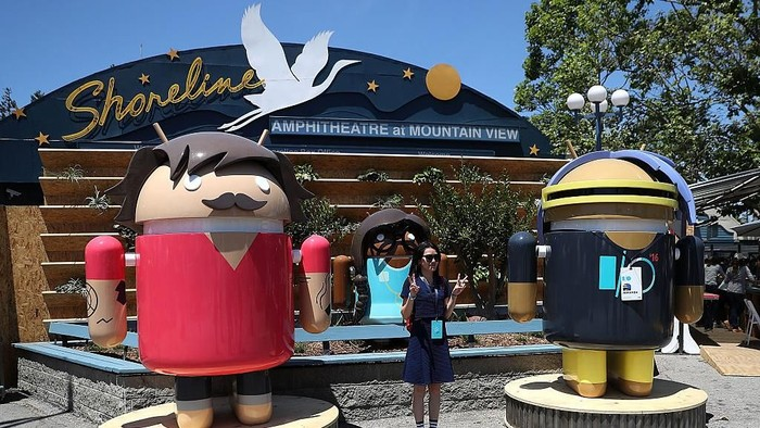 MOUNTAIN VIEW, CA - MAY 18:  An attendee poses for a photo next to Android characters during Google I/O 2016 at Shoreline Amphitheatre on May 19, 2016 in Mountain View, California. Google CEO Sundar Pichai delivered the keynote address to kick off the annual Google I/O conference that runs through May 20.  (Photo by Justin Sullivan/Getty Images)