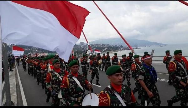 Usai dari JMP Bendera Merah Putih menuju Bandara Pattimura untuk diterbangkan ke Sorong dan berakhir di Merauke. (Muslimin Abbas/detikTravel)