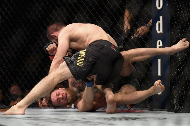 LAS VEGAS, NV - OCTOBER 06: Khabib Nurmagomedov of Russia (top) punches Conor McGregor of Ireland in their UFC lightweight championship bout during the UFC 229 event inside T-Mobile Arena on October 6, 2018 in Las Vegas, Nevada.   Harry How/Getty Images/AFP