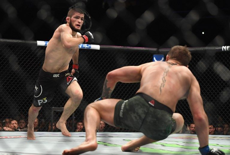 LAS VEGAS, NV - OCTOBER 06: Khabib Nurmagomedov of Russia (L) chases down Conor McGregor of Ireland in their UFC lightweight championship bout during the UFC 229 event inside T-Mobile Arena on October 6, 2018 in Las Vegas, Nevada.   Harry How/Getty Images/AFP