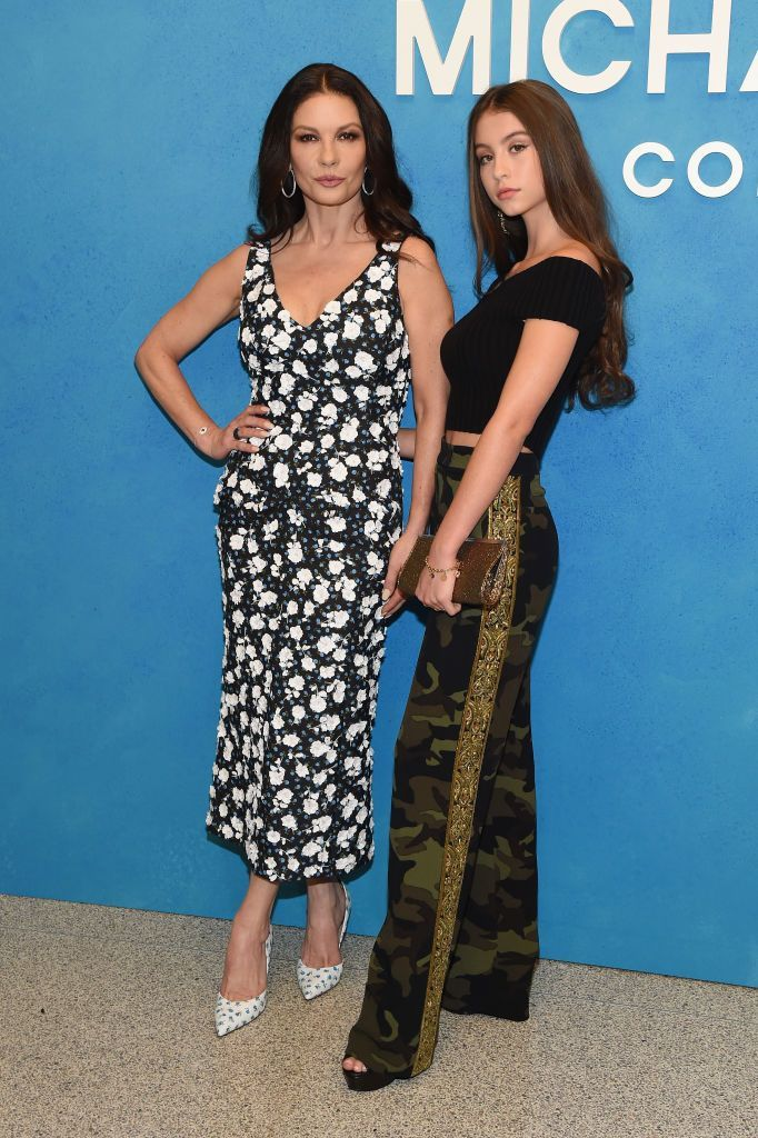 NEW YORK, NY - SEPTEMBER 12:  Catherine Zeta-Jones (L) and Carys Zeta Douglas attend the Michael Kors Collection Spring 2019 Runway Show at Pier 17 on September 12, 2018 in New York City.  (Photo by Larry Busacca/Getty Images for Michael Kors)