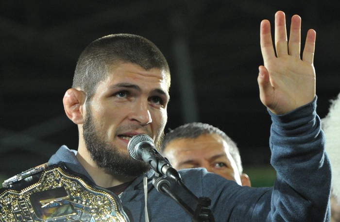 Russias Khabib Nurmagomedov, UFC lightweight champion who defeated Conor McGregor of Ireland in the main event of UFC 229, speaks during the ceremony of honouring him at Anzhi Arena in Kaspiysk, a city in the republic of Dagestan, Russia October 8, 2018. Picture taken October 8, 2018. REUTERS/Said Tsarnayev
