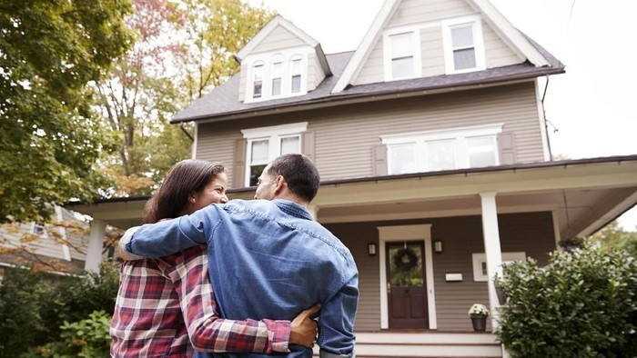 Rear View Of Loving Couple Walking Towards House