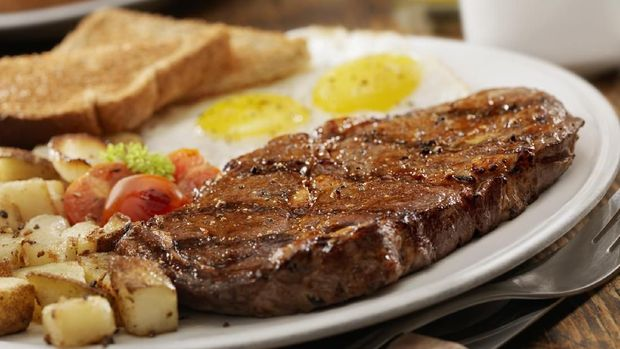 Grilled Rib Eye Steak with Sunny-side up Eggs, Hash Browns, Grilled Tomatoes and Toast -Photographed on Hasselblad H3D2-39mb Camera
