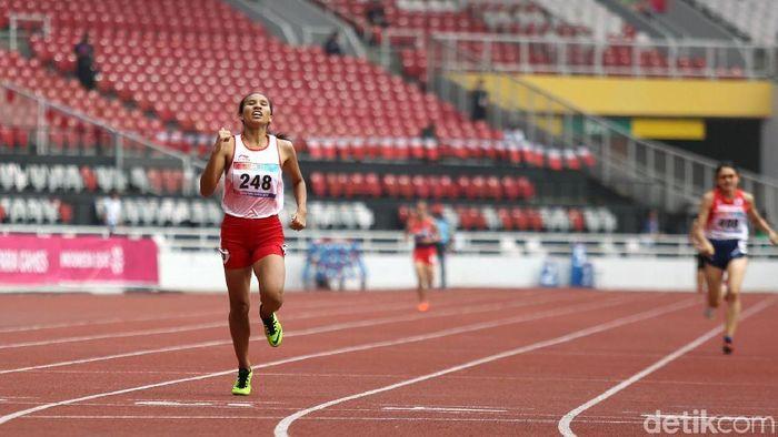 Ni Made Arianti saat tampil di lari 400 meter Asian Para Games 2018. (Agung Pambudhy/detikSport)
