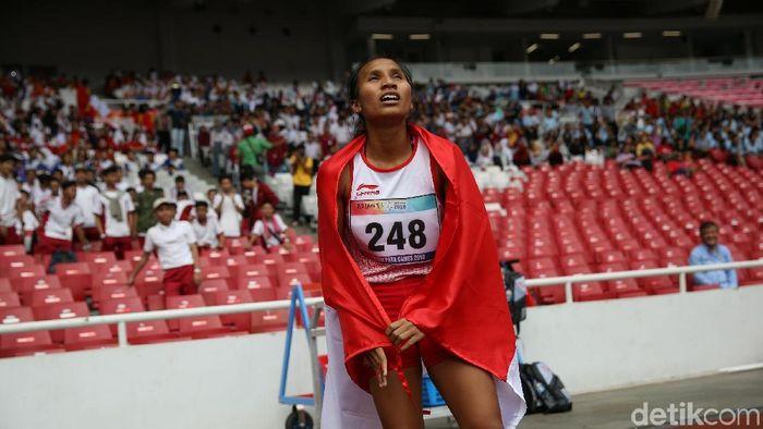 Ni Made Ariyanti meraih perak lari 400 meter T13. (Agung Pambudhy/detikSport)