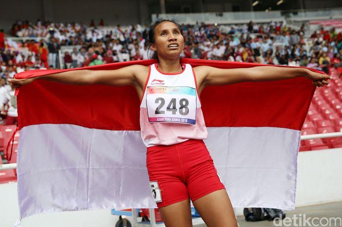 Ni Made Arianti meraih medali perak Asian Para Games 2018 dari lari 400 m T13 putri.
