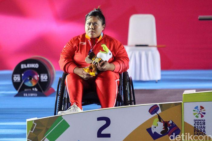 Tampil di Balai Sudirman, Jakarta, Kamis (11/10/2018), Sriyanti harus puas dengan medali perak di kelas 86 kg. Dia kalah tipis dengan wakil Korea Selatan, Lee Hyungjung.