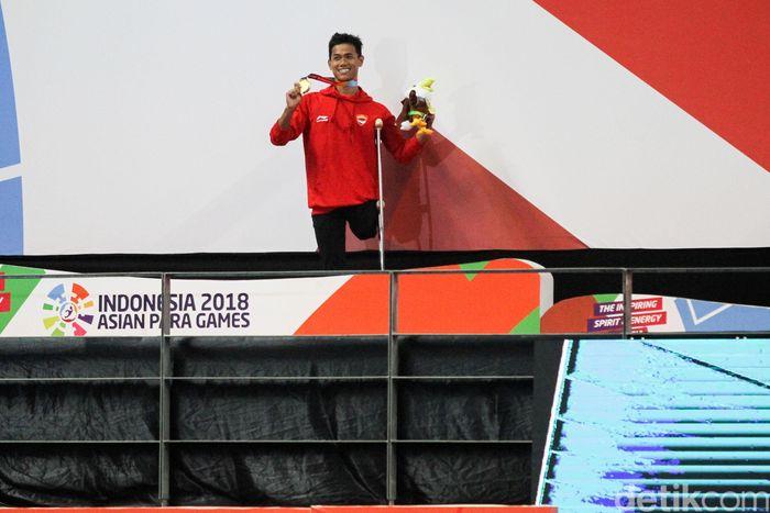 Jendi Pangabean meraih emas 100 meter gaya punggung S9 (tunadaksa) Asian Games 2018.