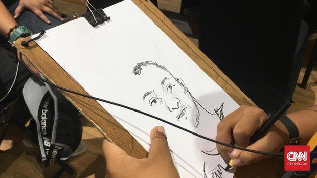 Keahlian Liben dalam melukis cepat ditunjukkan pada Asian Para Games 2018.
