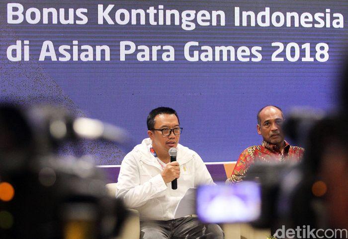 Menteri Pemuda dan Olahraga (Menpora) menjelaskan pencairan bonus Asian Para Games 2018 di GBK Arena, Jakarta, Jumat (12/10/2018).