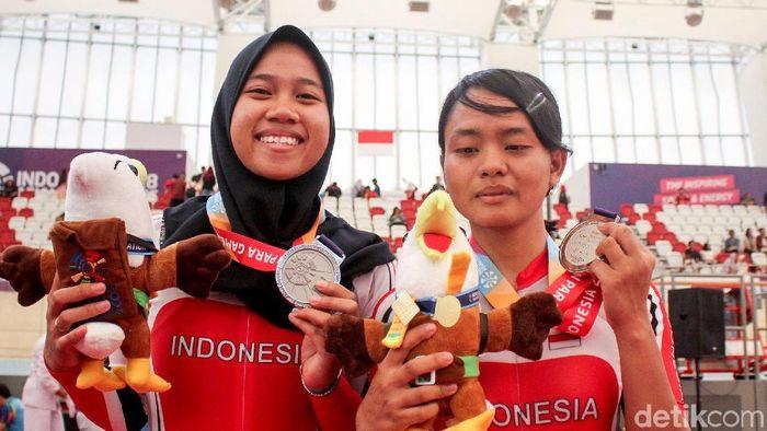 Sri Sugiyanti (kanan) menyumbangkan empat medali untuk Indonesia di Asian Para Games 2018. (Foto: Rifkianto Nugroho)