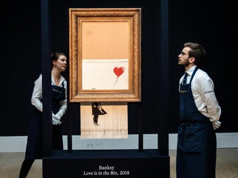 Alasan Museum di Jerman Tak Pungut Biaya untuk Lukisan Fenomenal Banksy Foto: Getty Images