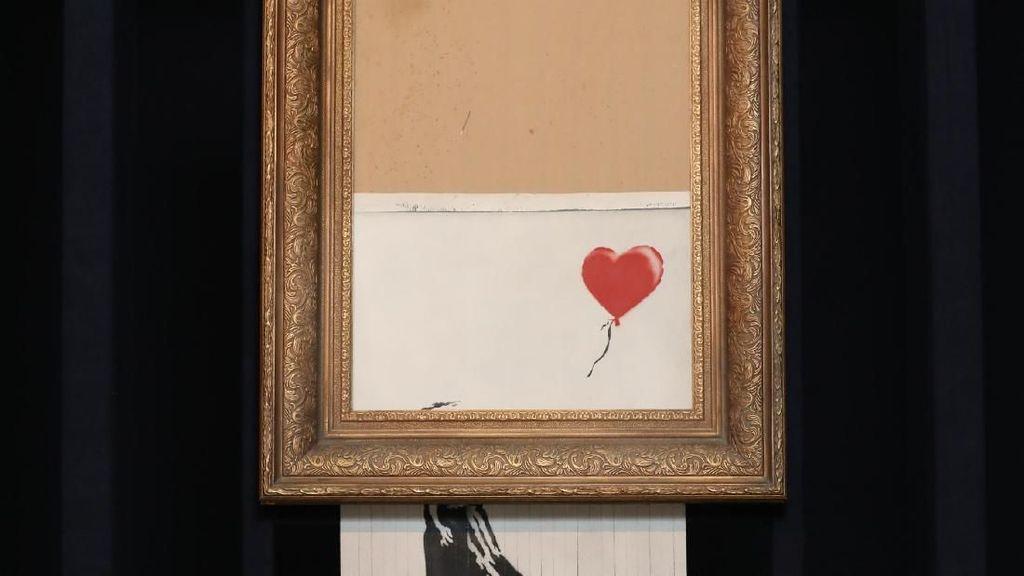 Rekor! Lukisan Robek Banksy Laku Rp 356 M