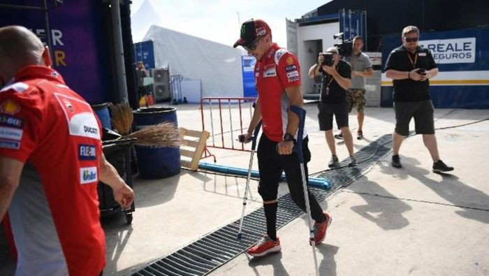 Jorge Lorenzo berharap bisa balapan di MotoGP Jepang. (Foto: Lillian Suwanrumpha/ AFP Photo)