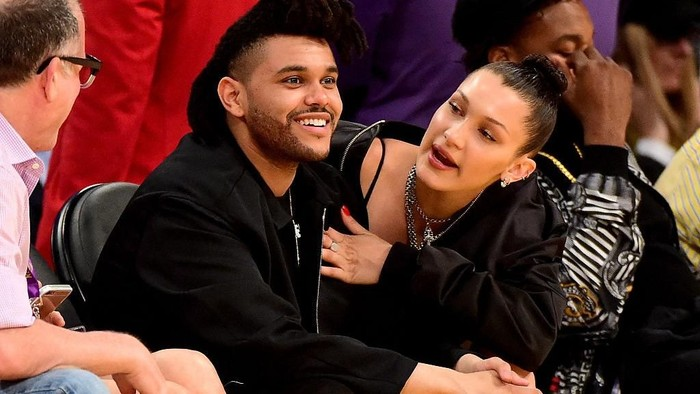 LOS ANGELES, CA - APRIL 13:  The Weeknd (Abel Tesfaye) & Bella Hadid are seen sitting courtside as the Los Angeles Lakers take on the Utah Jazz at Staples Center on April 13, 2016 in Los Angeles, California. NOTE TO USER: User expressly acknowledges and agrees that, by downloading and or using this photograph, User is consenting to the terms and conditions of the Getty Images License Agreement.  (Photo by Harry How/Getty Images)