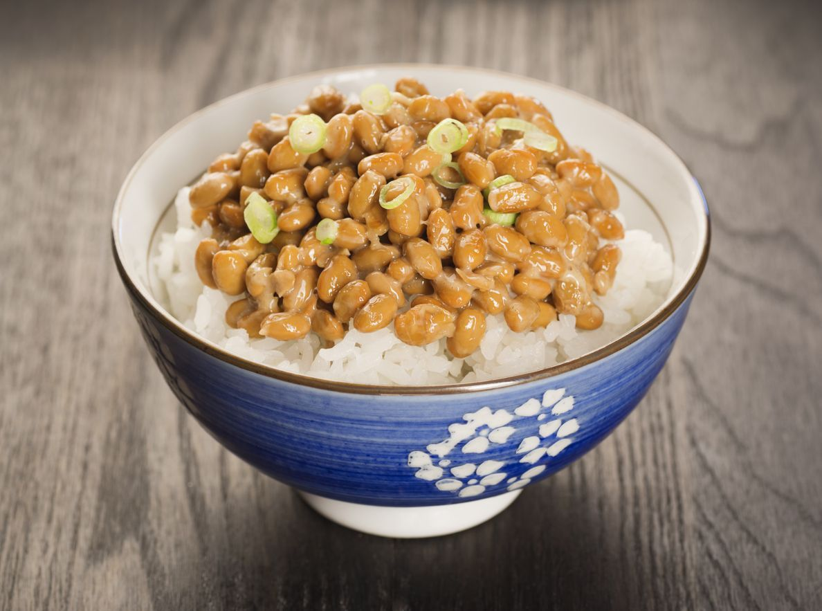 Natto is a Japanese dish made from fermented soybeans. It has a distinctive smell and sticky, stringy texture. It is frequently served over rice, topped with sliced green onions.