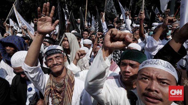 Setengah Hati Jokowi Redam Isu Pembakaran Bendera HTI