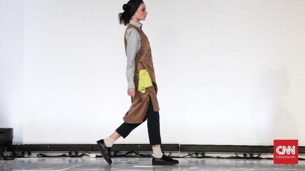 Peragaan busana label asal Jepang, Tategami, pada Jakarta Fashion Week 2019.