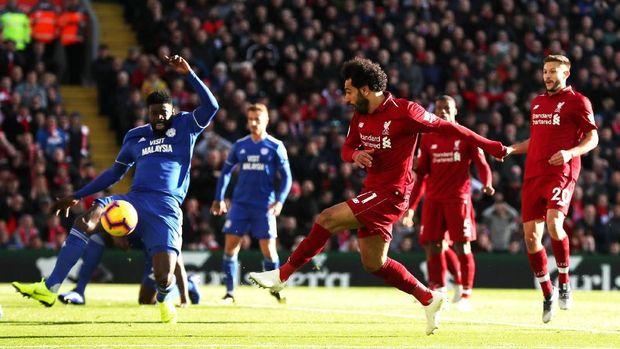 Liverpool tertinggal satu poin dari Manchester City dan wajib menang atas Cardiff City.