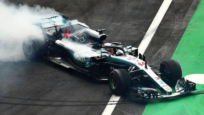 Lewis Hamilton juara dunia F1 2018 usai finis keempat di GP Meksiko. (Foto: Dan Istitene/Getty Images)