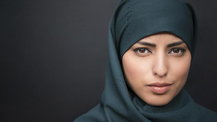 studio shot of young woman wearing traditional arabic clothing