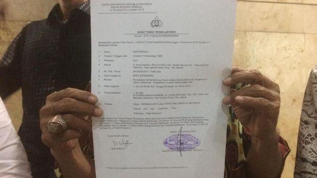 Surat tanda terima laporan Abu Janda. (Foto: Rolando Fransiscus/detikcom)