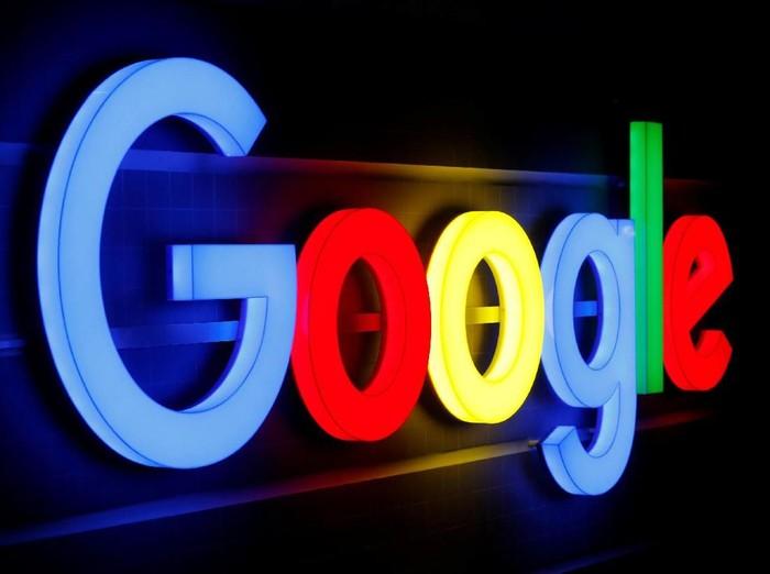 FILE PHOTO: An illuminated Google logo is seen inside an office building in Zurich September 5, 2018. REUTERS/Arnd WIegmann/File Photo