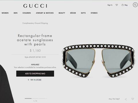 Kacamata Gucci.