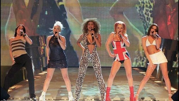 The hottest of the new wave of girl groups, The Spice Girls perform on stage at the Brit Awards ceremony held here late 24 FEB.  before picking up awards for the Best British Video and Best Single. (Photo by FIONA HANSON / PRESS ASSOCIATION / AFP)