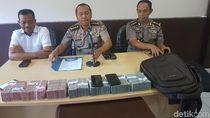 Polisi OTT Pengusaha Kayu di Papua, Rp 500 Juta Disita