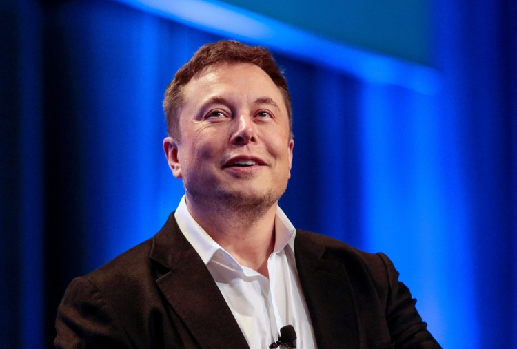 Tesla and SpaceX CEO Elon Musk smiles during a
