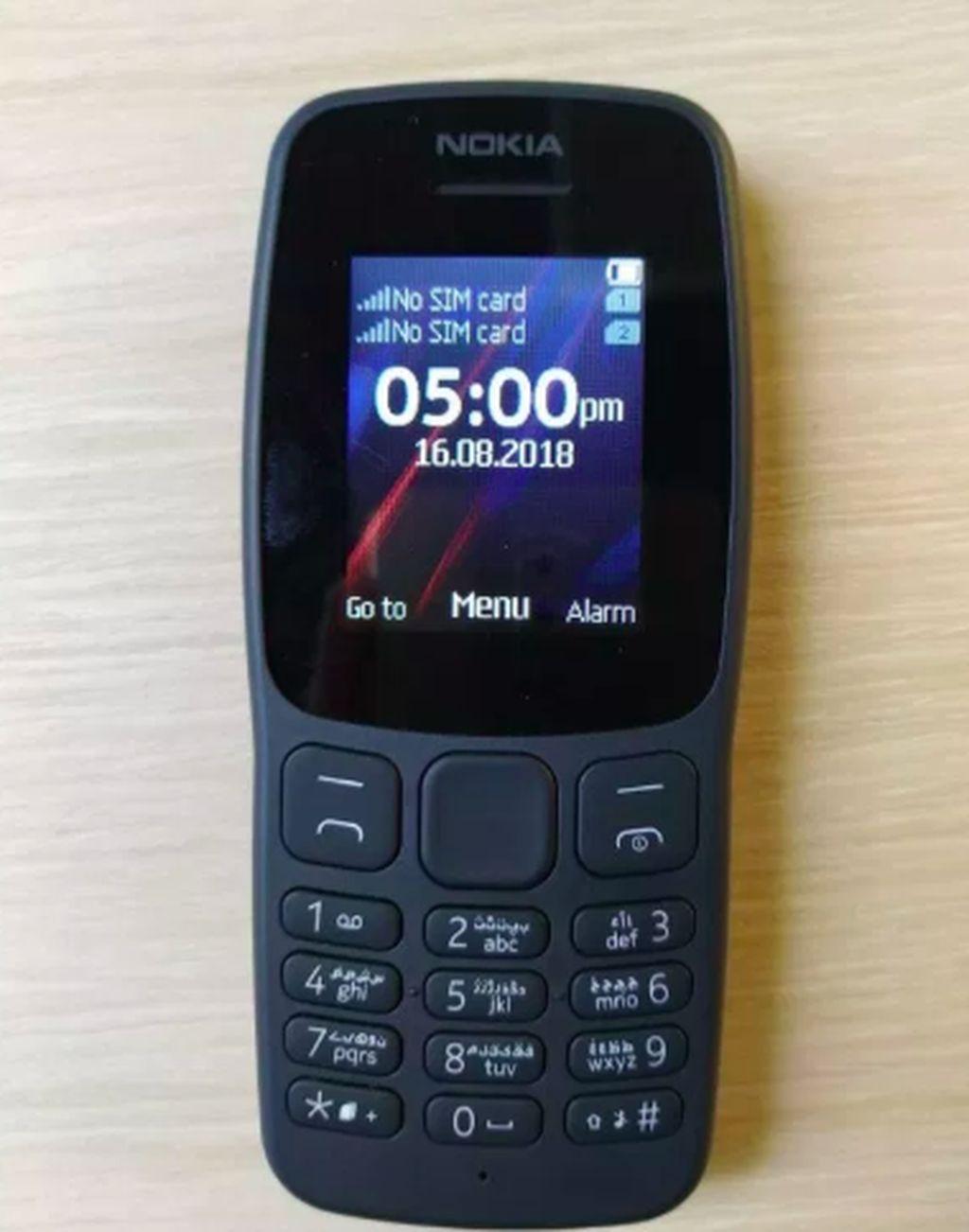 Nokia 106 ini adalah perbaikan dari ponsel dengan merek sama yang pernah rilis pada tahun 2013. Fiturnya kurang lebih sama saja, cuma baterainya lebih tahan lama. Foto: Nokia