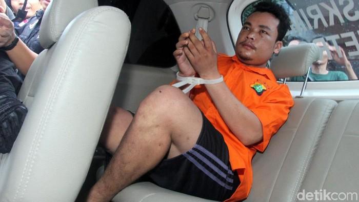 Haris Simamora (HS) tersangka pembunuhan satu keluarga di Bekasi. Foto: Lamhot Aritonang