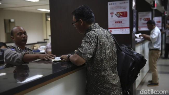 Pengurusan pajak kendaraan bermotor/Foto: Agung Pambudhy