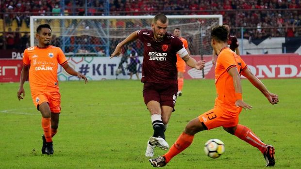 Persija dan PSM dalam perburuan gelar juara Liga 1 2018.