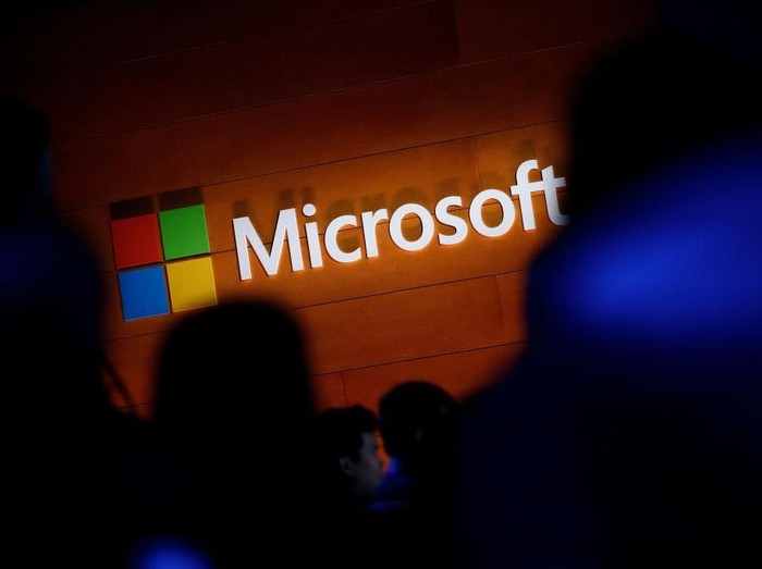 NEW YORK, NY - MAY 2: The Microsoft logo is illuminated on a wall during a Microsoft launch event to introduce the new Microsoft Surface laptop and Windows 10 S operating system, May 2, 2017 in New York City. The Windows 10 S operating system is geared toward the education market and is Microsofts answer to Googles Chrome OS. (Photo by Drew Angerer/Getty Images)