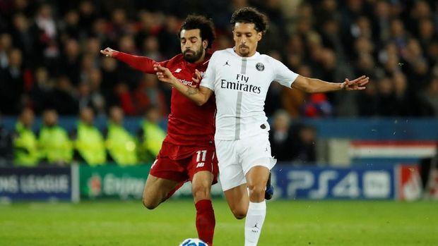 Mohamed Salah (kiri) berambisi membawa Liverpool juara, termasuk di Liga Champions. (