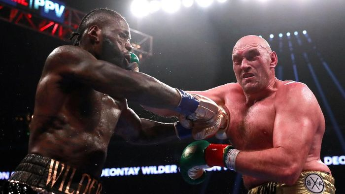 Duel Tyson Fury vs Deontay Wilder berakhir imbang (Andrew Couldridge/Reuters)
