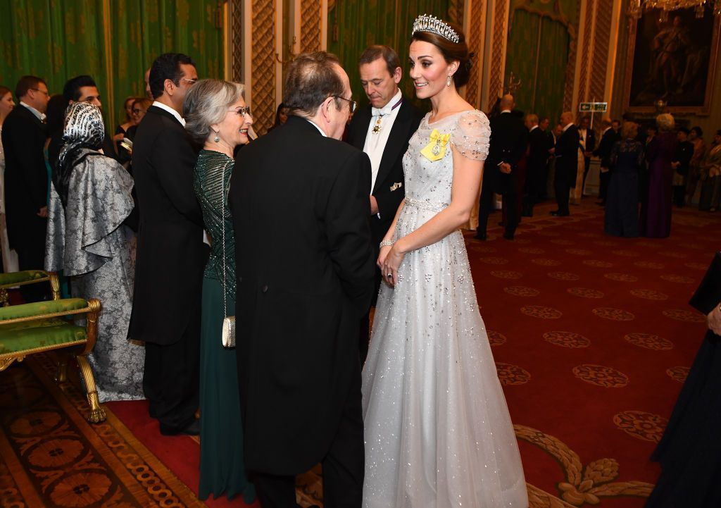 LONDON, ENGLAND - DECEMBER 04:   Catherine, Duchess of Cambridge greets guests at an evening reception for members of the Diplomatic Corps at Buckingham Palace on December 04, 2018 in London, England. Approximately 7,500 military personnel are currently serving overseas at Christmas.  (Photo by Victoria Jones - WPA Pool/Getty Images)