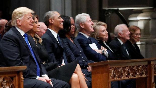 U.S. President Donald Trump, first lady Melania Trump, former President Barack Obama, former first lady Michelle Obama, former President Bill Clinton, former Secretary of State Hillary Clinton, former President Jimmy Carter and former first lady Rosalynn Carter participate in the State Funeral for former President George H.W. Bush, at the National Cathedral, Wednesday, Dec. 5, 2018 in Washington. Alex Brandon/Pool via REUTERS