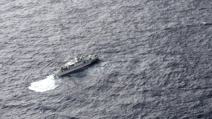 A Japan Coast Guard patrol vessel sails on the water at the area where two U.S. Marine Corps aircraft have been involved in a mishap in the skies, off the coast of Kochi prefecture, Japan, in this aerial view photo taken by Kyodo December 6, 2018.  Mandatory credit Kyodo/via REUTERS ATTENTION EDITORS - THIS IMAGE WAS PROVIDED BY A THIRD PARTY. MANDATORY CREDIT. JAPAN OUT. NO COMMERCIAL OR EDITORIAL SALES IN JAPAN.