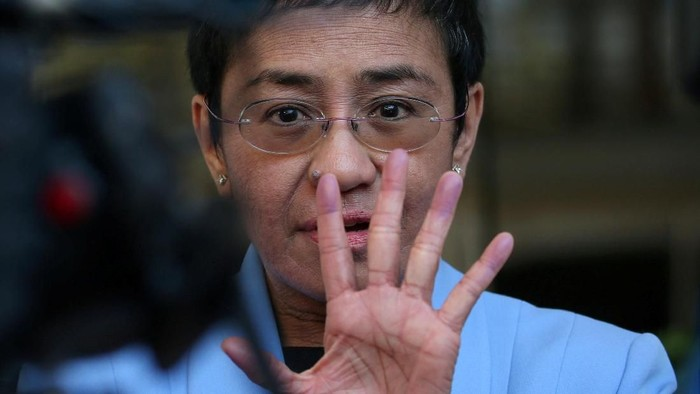Maria Ressa, an executive of online news platform Rappler, speaks to the media after posting bail for tax evasion charges at Regional Trial Court Branch 265 in Pasig City, Metro Manila, in Philippines, December 3, 2018. REUTERS/Eloisa Lopez