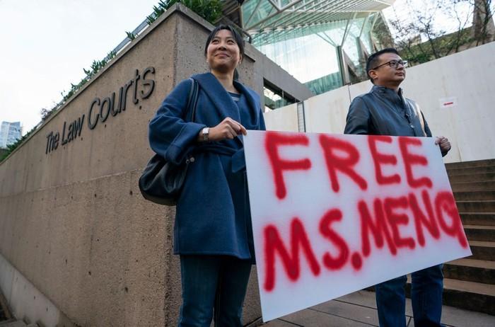 Aksi demo menuntut pembebasan bos Huawei. Foto: Rich Lam/Getty Images