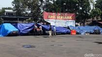 Mobil yang Dirusak di Polsek Ciracas Ditutupi Terpal